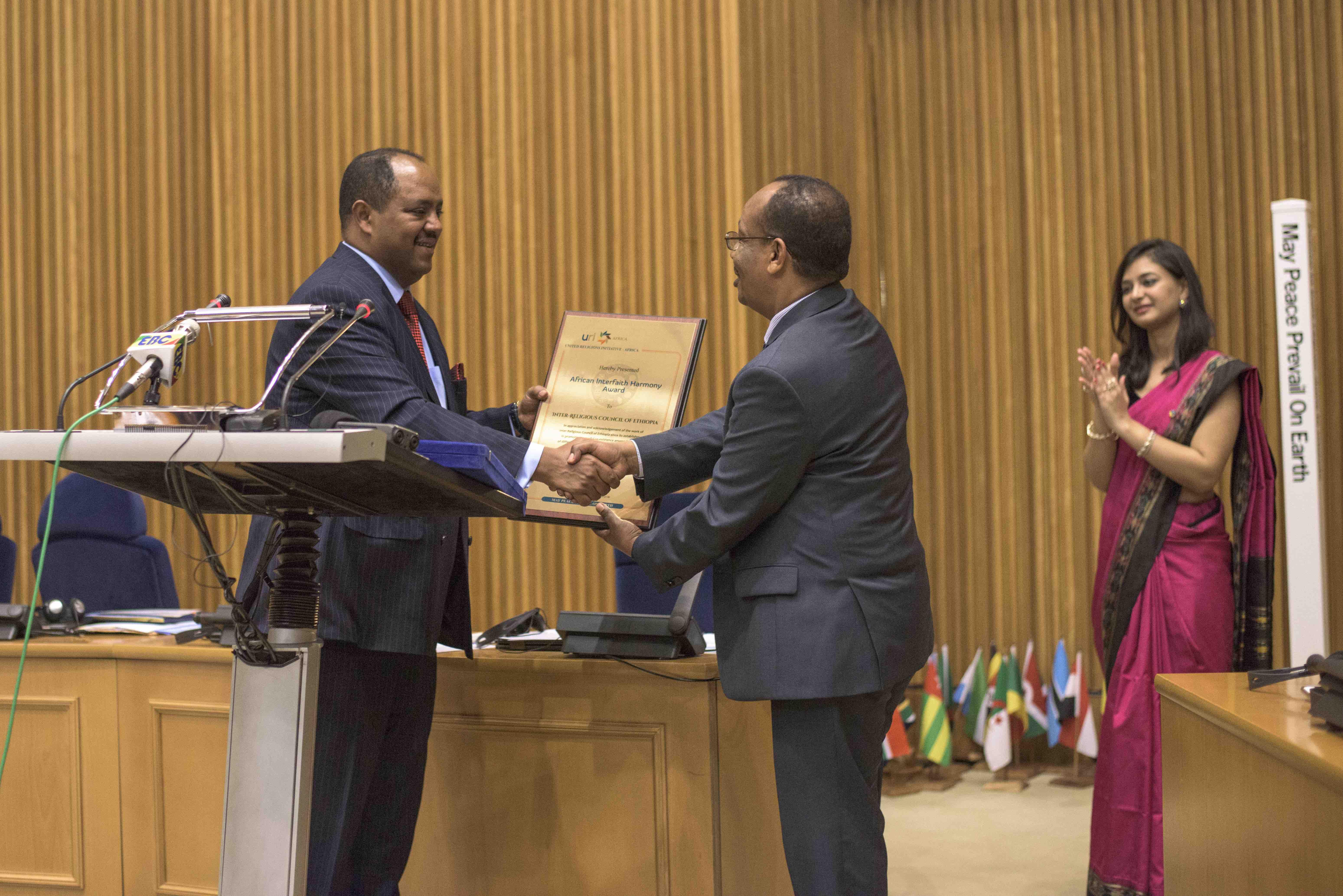 Amb Mussie Presents Interfaith Award - Rajiv.jpg