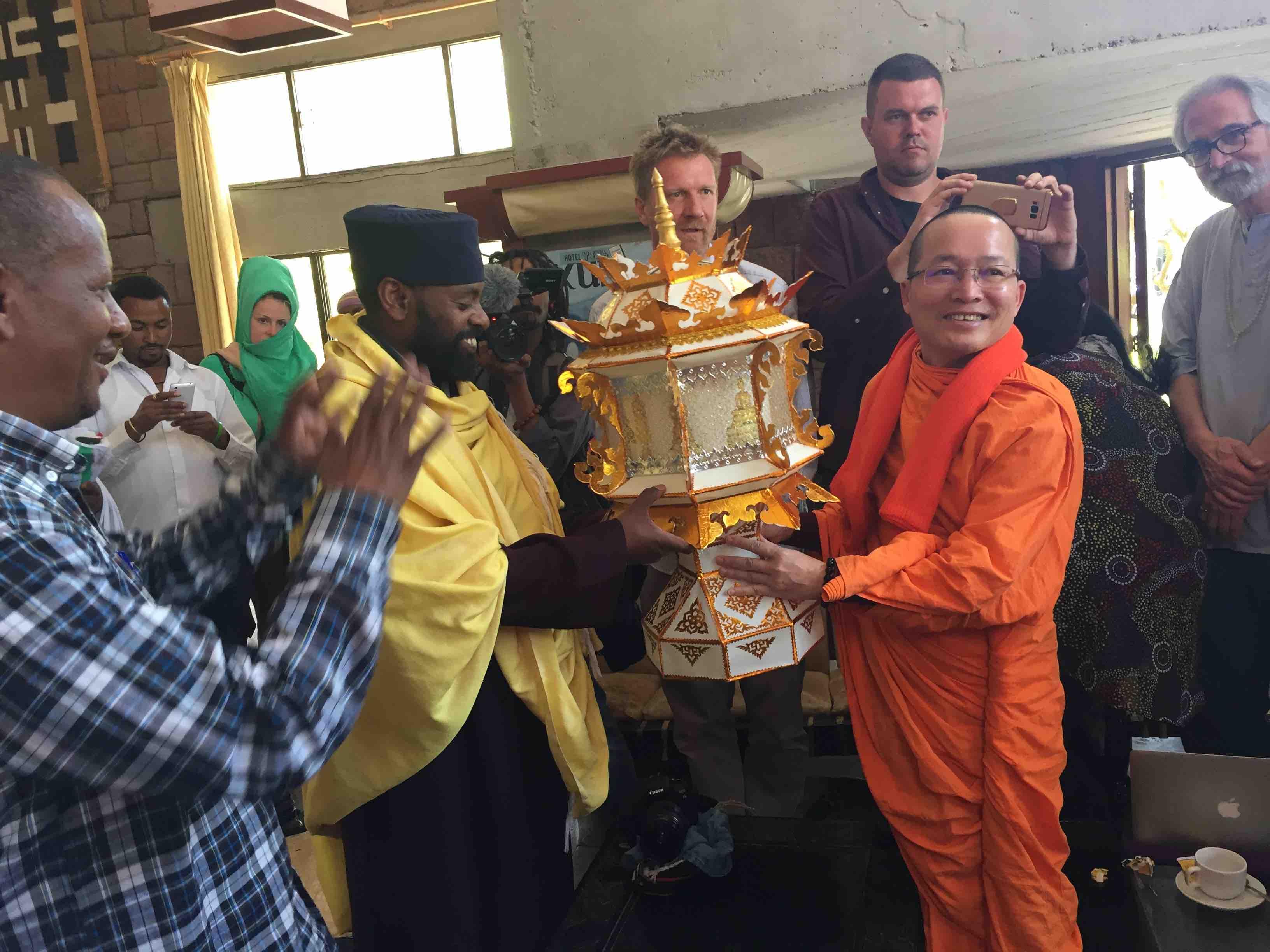 Buddhist Monk Presents Lamp to Ehtiopian Abbot.jpg